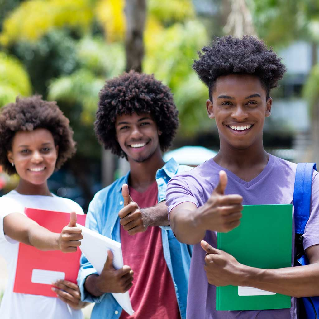 Group of three African American college students giving a thumbs up